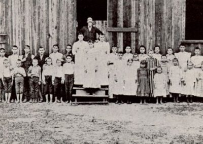 Professor Young and his pupils in front of Lee's Creek Schoolhouse